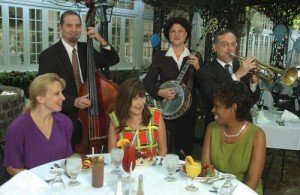 Court of Two Sisters diners are entertained by strolling jazz musicians