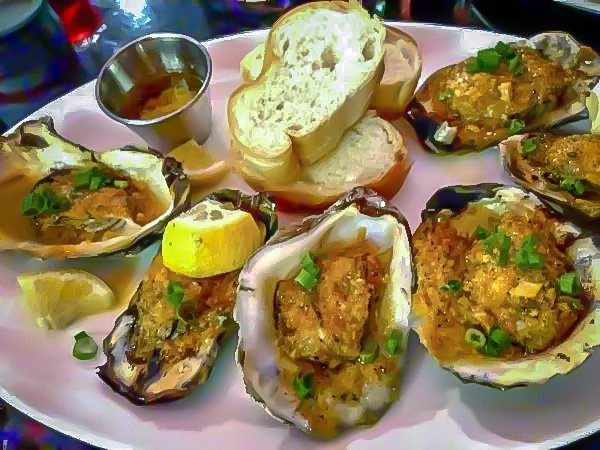 Chargrilled oysters with Crystal Hot Sauce and garlic parmesan butter